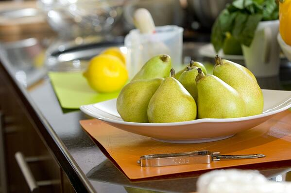 pears sitting in fruit plate